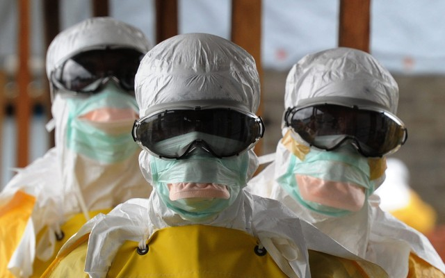 Health care workers, wearing protective suits, leave a high-risk area at the French NGO Medecins Sans Frontieres (Doctors without borders) Elwa hospital on August 30, 2014 in Monrovia. Liberia has been hardest-hit by the Ebola virus raging through west Africa, with 624 deaths and 1,082 cases since the start of the year. AFP PHOTO / DOMINIQUE FAGET        (Photo credit should read DOMINIQUE FAGET/AFP/Getty Images)