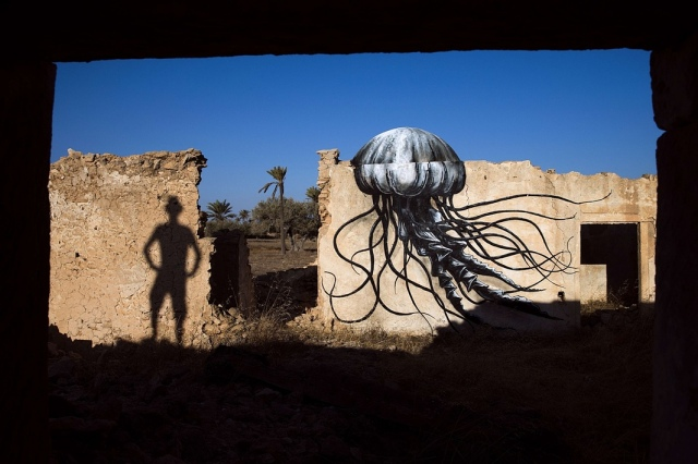 Djerba. A mural by Belgian artist ROA decorates an abandoned wall. Photograph: Joel Saget/AFP/Getty Images. Source: theguardian.com
