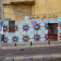Street art in Beirut, it says Beirut is more beautiful by bicycle.
