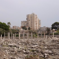 The new city of Tyre rises behind the ruins of ancient Tyre.