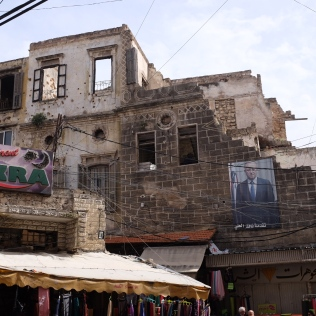 Tripoli wearing battle scars with grace. Markets and business continue beneath the ruins.