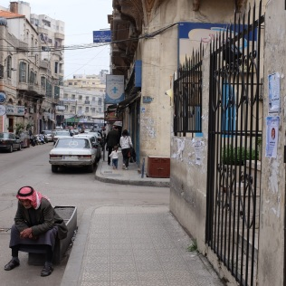 A man takes a break from long and hard days in Tripoli.